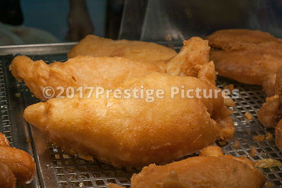 Pieces of Battered Fish in a Fish and Chup Shop