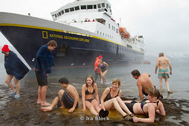 Passengers from the National Geographic Explorer enjoying the hot spring on the beach of Whaler's Bay, Deception Island.