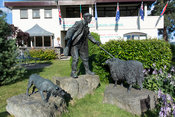 Bronze statue of shepherd and collie sheepdog with a sheep at the Royal Welsh Showground, Wales.