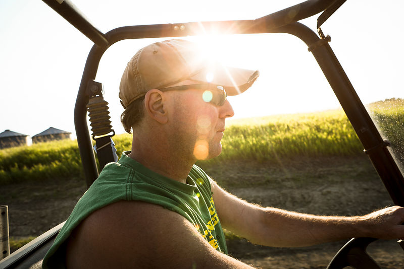 Brian Kudelka, a fabricator from Forman, North Dakota, drives through the fields of his grandfather's farm