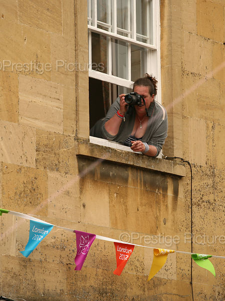 Photographer Leaning out of Upstairs Window