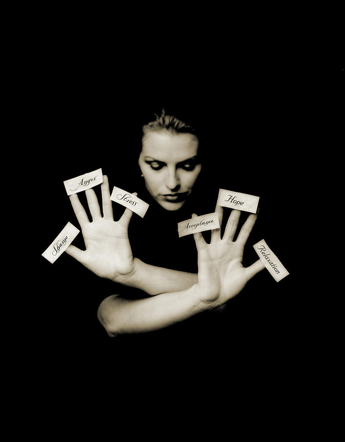 Woman with labels on her hands