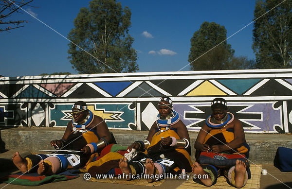 Ndebele women producing beadwork and painting, Botshabelo Ndebele village, South Africa
