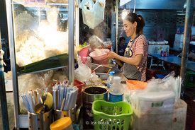 A night scene at the food markets in Chinatown of Bangkok.