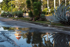 Early morning after a rainstorm, puddles in the street reflect the Palacio del Valle in Cienfuegos, Cuba