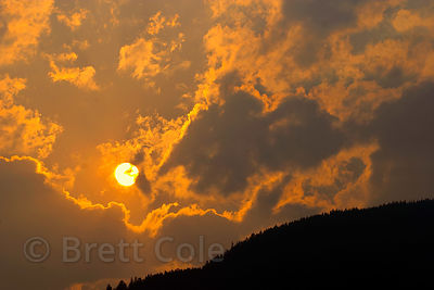 Sunset during a forest fire over Jasper NP, Canadian Rockies.
