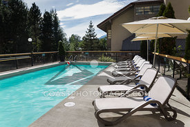 August 24th, 2015: Whistler BC. Poolside at Whistlers Crystal Lodge on a sunny summer day. Photo by Brad Kasselman - coastphoto.com