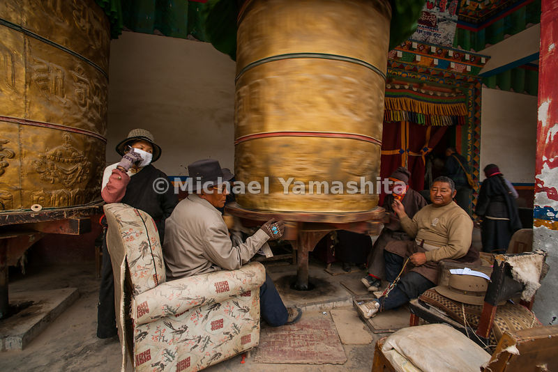 These men show that one needn't be standing to receive the benefits and good karma of a clockwise turn of a prayer wheel.