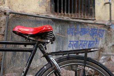 Bicycle with a bright red seat, Jodhpur, Rajasthan, India
