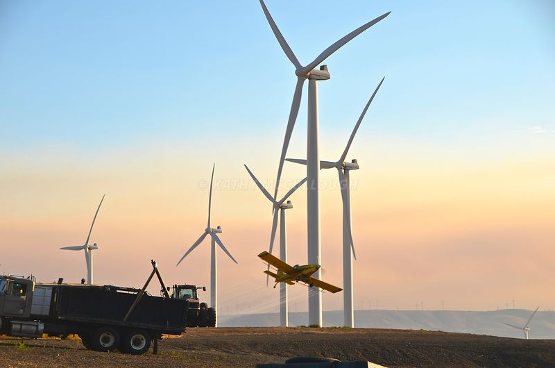Crop duster in the wind turbines