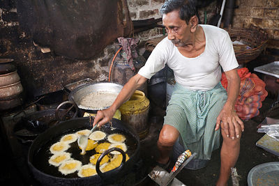 India - Chandannagar - Men making sweets at Seal Sweets