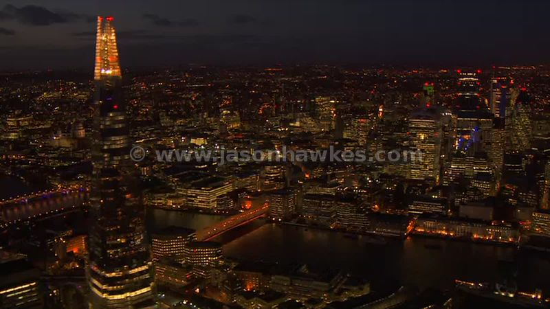 Aerial footage of the City and The Shard at night, London