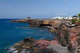 Rugged volcanic coastline, Las Coloradas, Playa Blanca, Lanzarote, Canary Islands, Spain. Stock Photo 