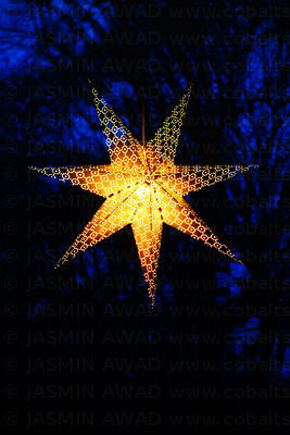 Holiday star in window with reflections