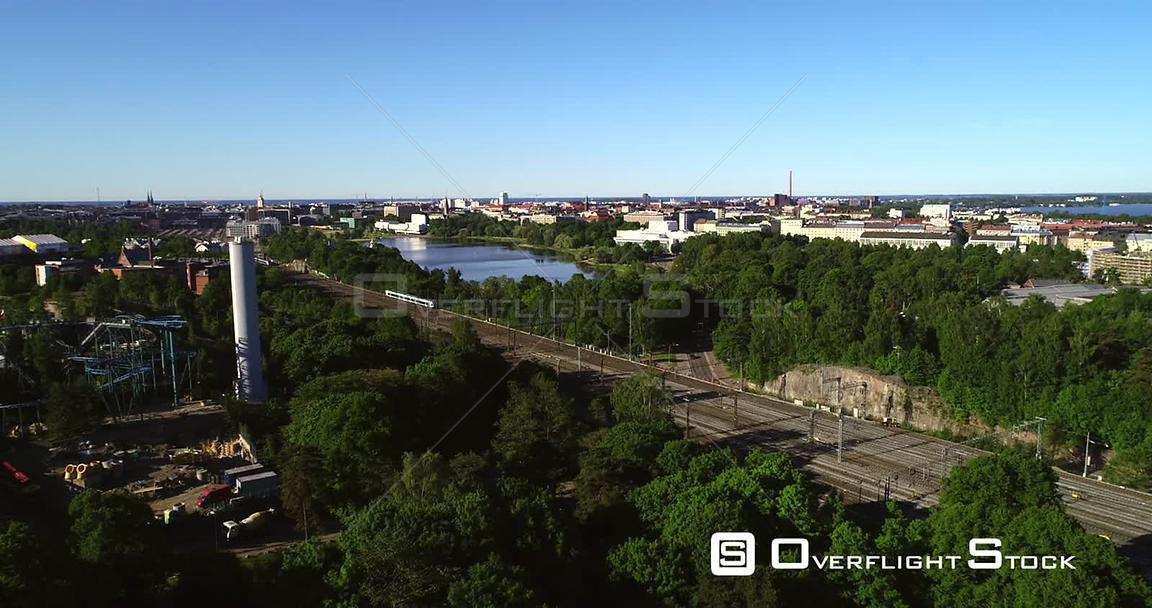 Train in a City, Aerial View Following a Train Leaving the Railway Station, in Helsinki, on a Sunny Summer Morning Dawn, in Helsingfors, Uusimaa, Finland