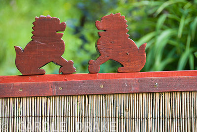 Two small carved lions on a gate into the kitchen garden. Beggars Knoll, Newtown, Westbury, Wiltshire, BA13 3ED, UK