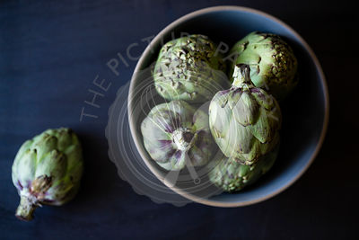 Artichokes on a blue background