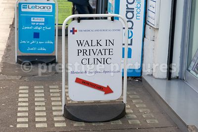 Street Board Advertising a Private Clinic
