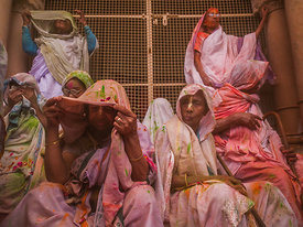 This photograph of an old widow looking curiously at something through her purdah was shot during the holi celebrations in Vrindavan