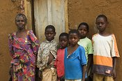 Old widow, looking after 6 grandchildren, whose parents died with HIV AIDS, Kampala region, Uganda Africa.