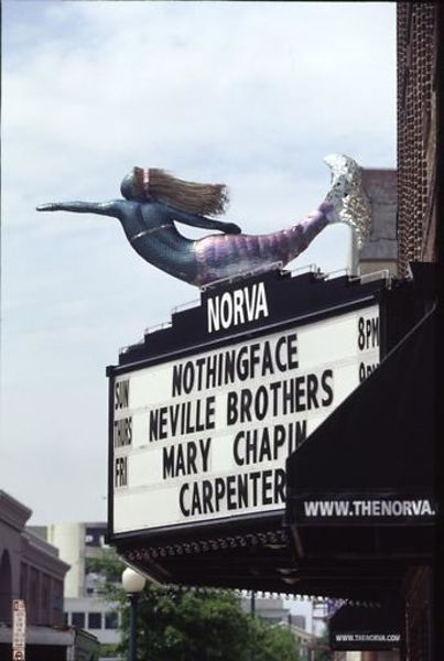 Norva theater marquee with the neville brothers mary chapin carpenter and nothingface. A mermaid on top. 2003