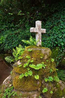 An old cross in the Convent of the Capuchos, dating back to the 16th century, in the middle of the Sintra mountain range forest, a Unesco World Heritage Site. Portugal