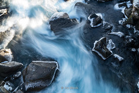 Water rushing over rocks at Thingvellir National Park in southwestern Iceland.