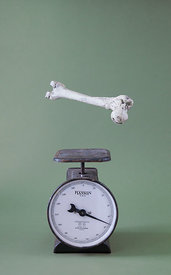 Bone floats above scale to show Osteoporosis