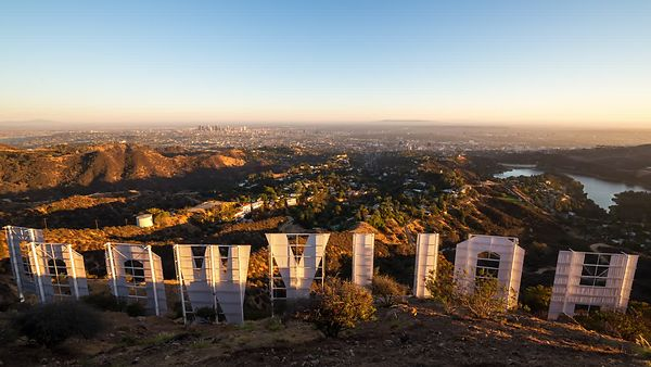 Bird's Eye of The Lighting Of Los Angeles From The Hollywood Sign's Point Of View (Clear Sky Sunset)