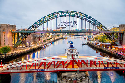 The Swing Bridge and the Tyne Bridge early morning with ,ights reflecting in the water