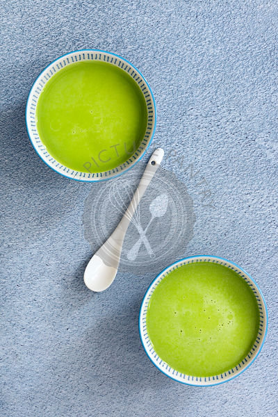 Two cups of brewed matcha green tea.