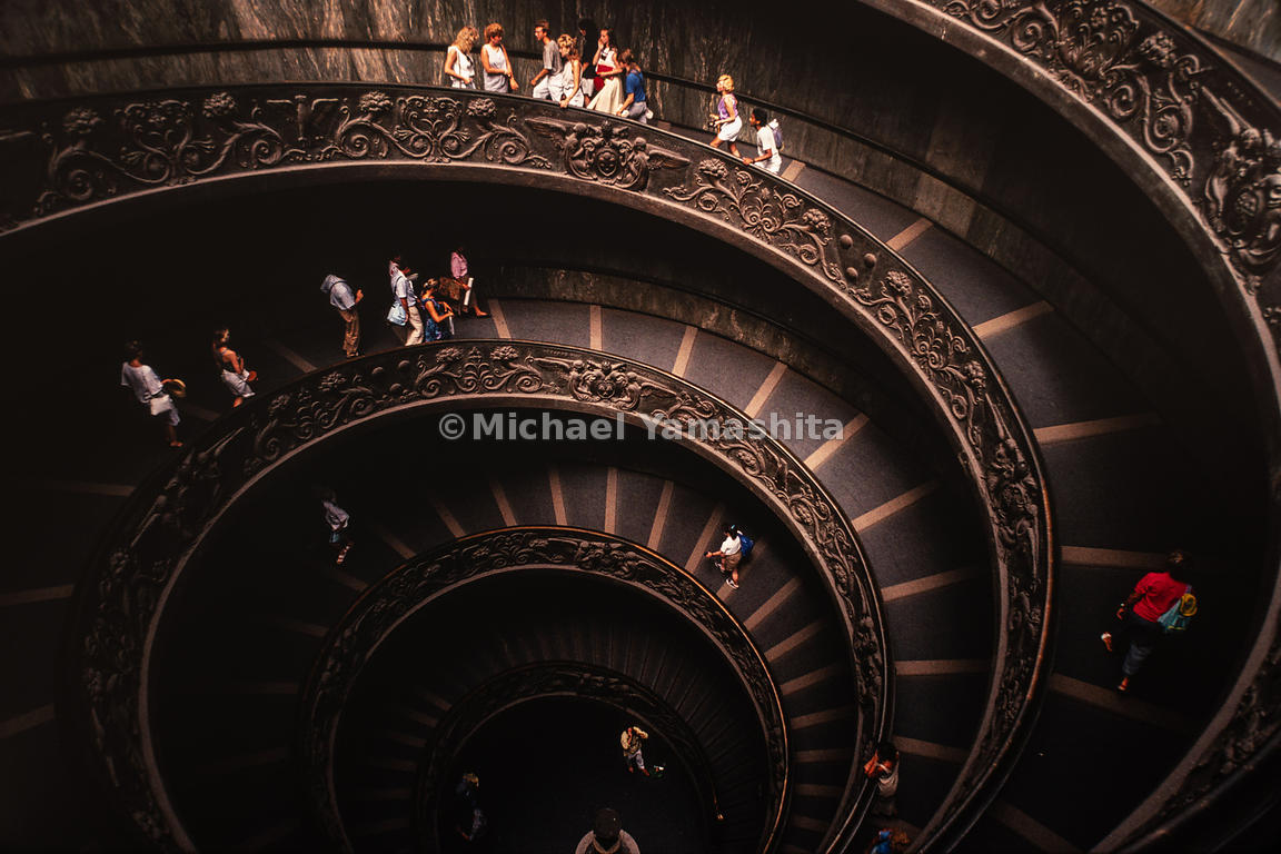 People walk up and down the Bramante Staircase at the Vatican museum. Rome, Italy, 1988.