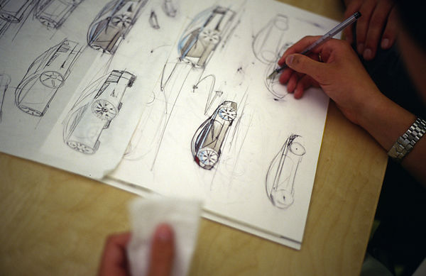 UK - Coventry - A designer works on the plans of a new Jaguar car