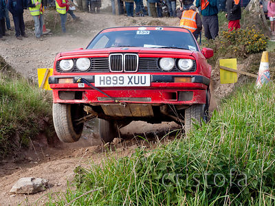 a BMW 318is leaps up the last steep hill on the Blue Hills section of the MCC Land's End Trials