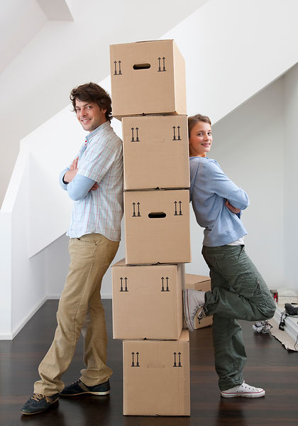 Couple with stack of cardboard boxes