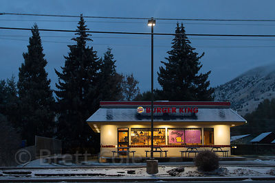 A Burger King store is illuminated in pre-dawn in Klamath Falls, Oregon