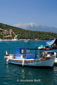 Fishing boats moored in Vathi harbour, Meganisi island, Lefkada, Ionian Islands, Greece.