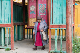 "A woman after turning a prayer wheel at Gandantegchinlen Monastery, Monglia's largest functioning Buddhist monastery in Ulaanbaatar.  The Tibetan name translates to the ""Great Place of Complete Joy""."