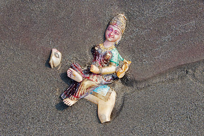 Broken idol in the Ganges River sand, Haridwar, India