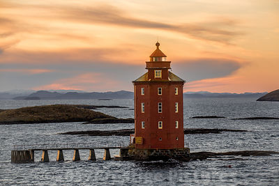 Octagonal Kjeungskjær Lighthouse in the light of a sunset