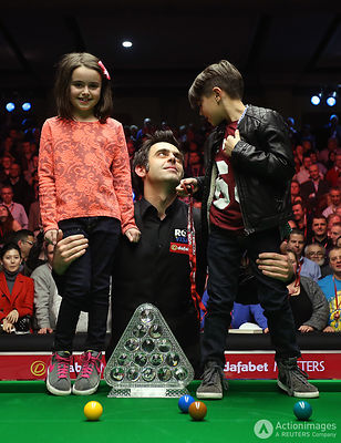 Snooker - The Dafabet Masters - Alexandra Palace, London - 19/1/14 Ronnie O'Sullivan celebrates winning the Dafabet Masters with the trophy, his daughter Lily and son Ronnie junior Mandatory Credit: Action Images / Steven Paston Livepic EDITORIAL USE ONLY.