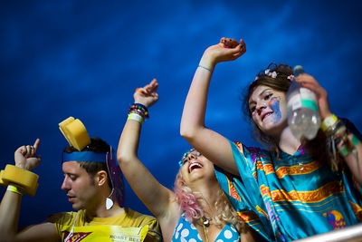 UK - Standon - Audience members in costume listen to and cheer  performers at the Standon Calling Festival