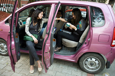 India - New Delhi - Young people eat and socialise in a car in Khan Market