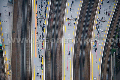 Aerial view of people waiting on the platforms of London Bridge Station