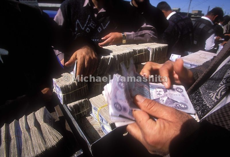 Money Traders exchange Dinar in Salaimnya, Iraq.