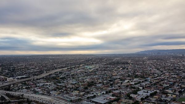 Bird's Eye: Low Stratus Clouds Blanketing Busy Highways in the Dense City
