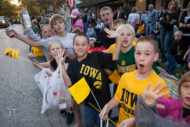 Parade spectators wave  during the  University of Iowa homecoming Parade in Iowa City on Friday September 28, 2012. (Justin Torner/Freelance)