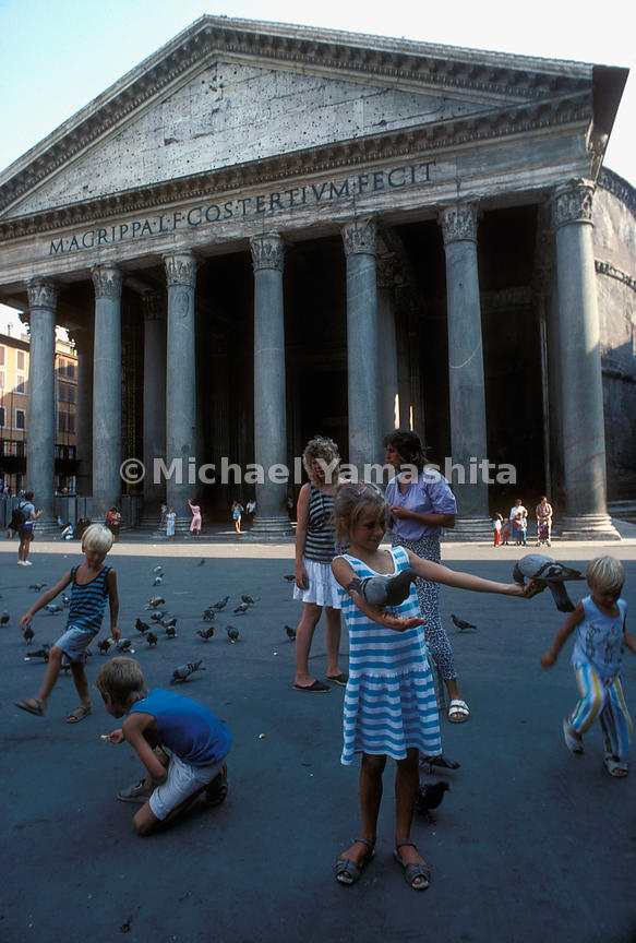 Children in front of the Pantheon feeding the pigeons. Rome, Italy.