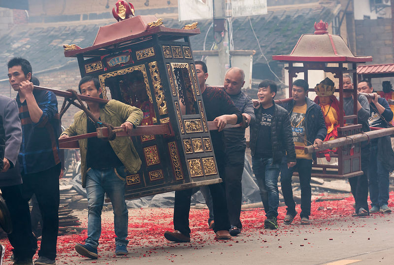 Buddhist procession after Spring rains. The Buddha images from every surrounding temple are carried in procession to be placed together. Jin Dou village, a tea-growing community in Quanzhou, Fujian