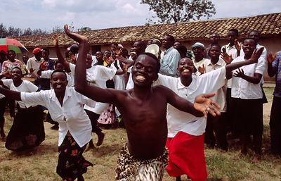 Rwanda - Kibileze - Traditional Rwandan dancers perform and villagers dance for a spectacle warning of the dangers of HIV and AIDS.